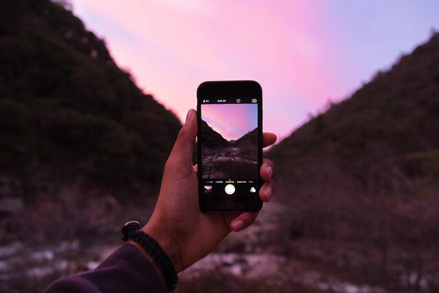 Taking picture of sunset in mountains.jpg