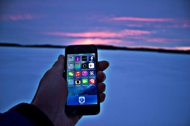 holding phone sunset.jpg