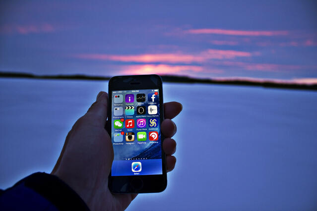 holding phone sunset.jpg
