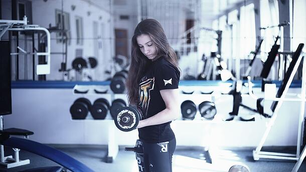 girl lifting weight.jpg